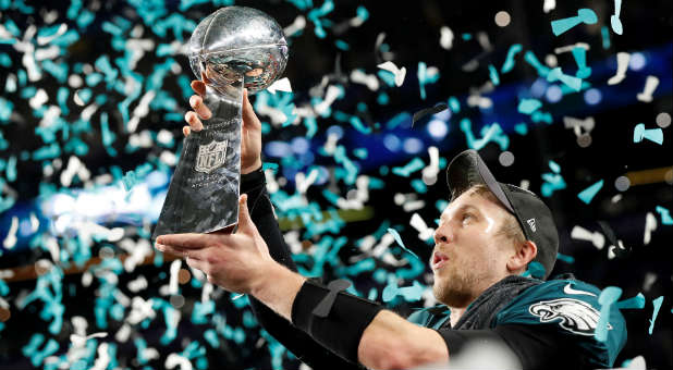 Philadelphia Eagles' Nick Foles celebrates with the Vince Lombardi Trophy after winning Super Bowl LII.