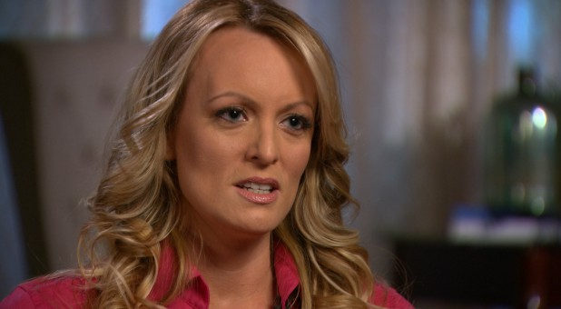 """Stormy Daniels, an adult film star and director whose real name is Stephanie Clifford is interviewed by Anderson Cooper of CBS News' """"60 Minutes"""" program in early March 2018."""