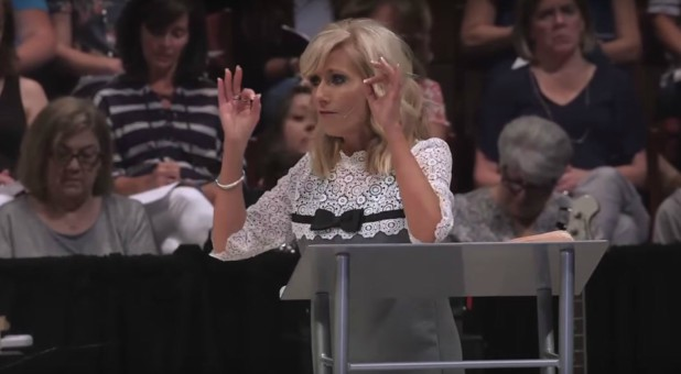 Beth Moore delivers a sermon.