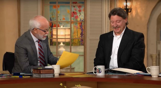 Jim Bakker, left, talks with Mark Taylor, right.