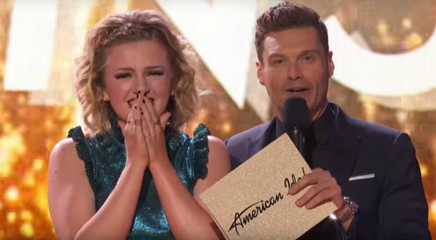 Maddie Poppe, left, with host Ryan Seacrest.