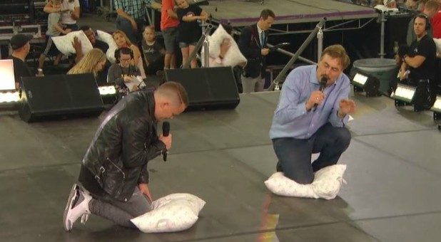 Nick Hall and Mike Lindell pray after a pillow fight.
