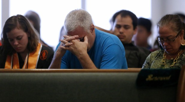 Members of the community attend a prayer service at the Arcadia First Baptist Church in Santa Fe, Texas.
