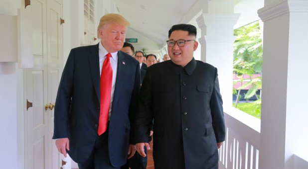 U.S. President Donald Trump walks with North Korean leader Kim Jong Un at the Capella Hotel on Sentosa island in Singapore.