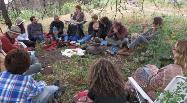A dozen people gather in a quiet spot in the Ventura River Preserve about 70 miles north of Los Angeles for a Sunday meeting of the Ojai Church of the Wild.