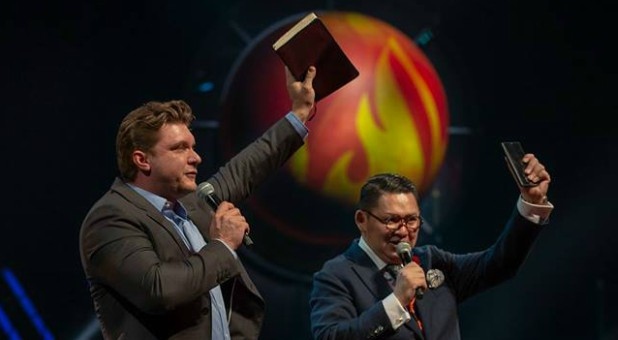 Daniel Kolenda, left, preaches at the Asia congress for Empowered21.