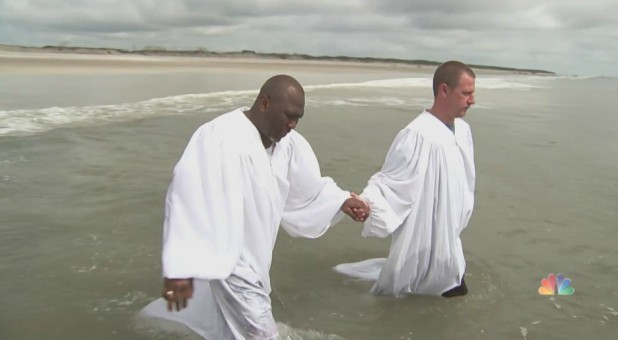 Ken Parker, right, prepares for baptism.