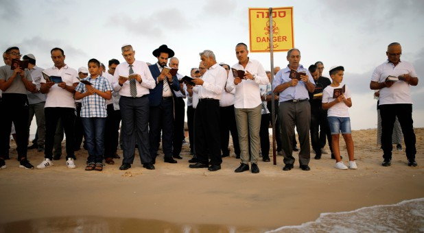 Jews take part in the Tashlich prayer, a Rosh Hashanah ritual, on the shores of the Mediterranean Sea.