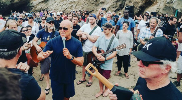 Greg Laurie speaks at a mass baptism in September.