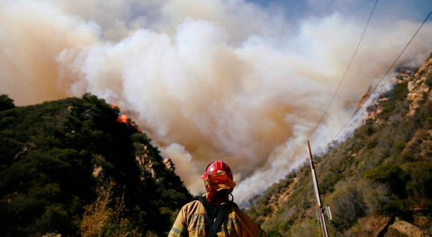 Firefighters battle the Woolsey Fire as it continues to burn in Malibu, California.
