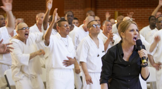Katie Souza, right, worships in prison.