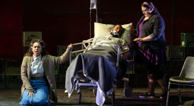 "With Daddy (Timothy J. Bruno) dying, his wife Nelda (Eliza Bonet), left, and estranged daughter Kayla (Alexandria Shiner) have different feelings toward him in AOI's ""Taking Up Serpents"" production by Washington National Opera at the Kennedy Center."