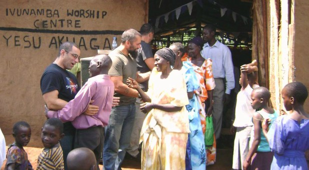 Pastor Steve Ferrante and longtime Colorado friend Todd Oliver greet members of the Ivunamba Worship Centre outside their temporary mud church.