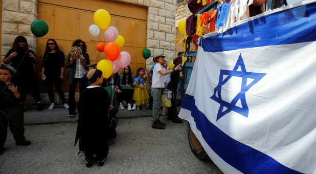 Israeli settlers celebrate the Jewish holiday of Purim, in Hebron in the Israeli-occupied West Bank.