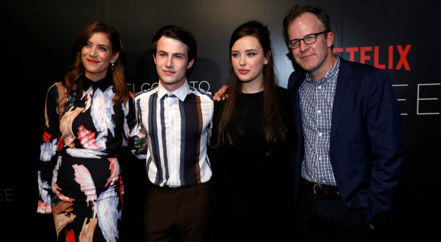 "Director Tom McCarthy (R) poses with cast members Kate Walsh (L), Dylan Minnette and Katherine Langford at a screening for the television series ""13 Reasons Why."""