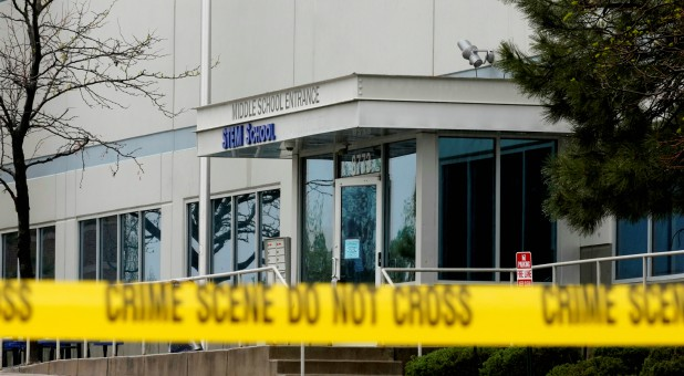 Crime scene tape is seen outside the school following the shooting at the Science, Technology, Engineering and Math (STEM) School in Highlands Ranch, Colorado.