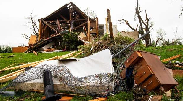 A mattress and dresser drawer are among the debris scattered on a lawn near a damaged house after several tornadoes reportedly touched down, in Linwood, Kansas.