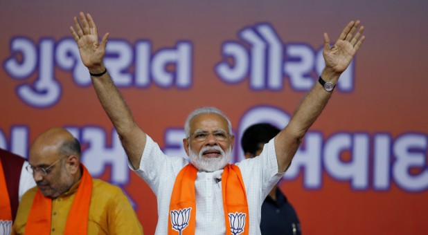India's Prime Minister Narendra Modi gestures as he arrives to address his supporters at a public meeting in Ahmedabad, India.
