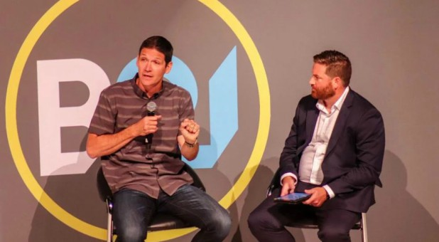 Matt Chandler, left, answers questions posed by Nate Akin during the Baptist21 luncheon held during a break in the annual meeting of the Southern Baptist Convention in Birmingham, Alabama.