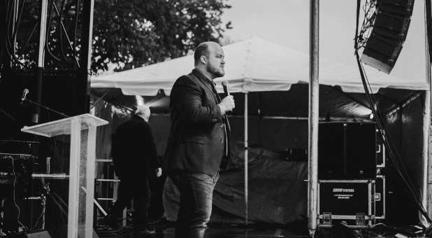 """Jeremiah Johnson preaches on the National Mall in Washington, D.D. as part of the """"As One"""" rally, Nov. 1, 2020."""